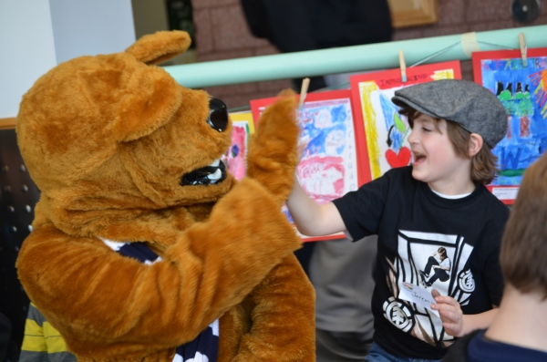 The Nittany Lion gets to know one of the young artists from The Walden School.